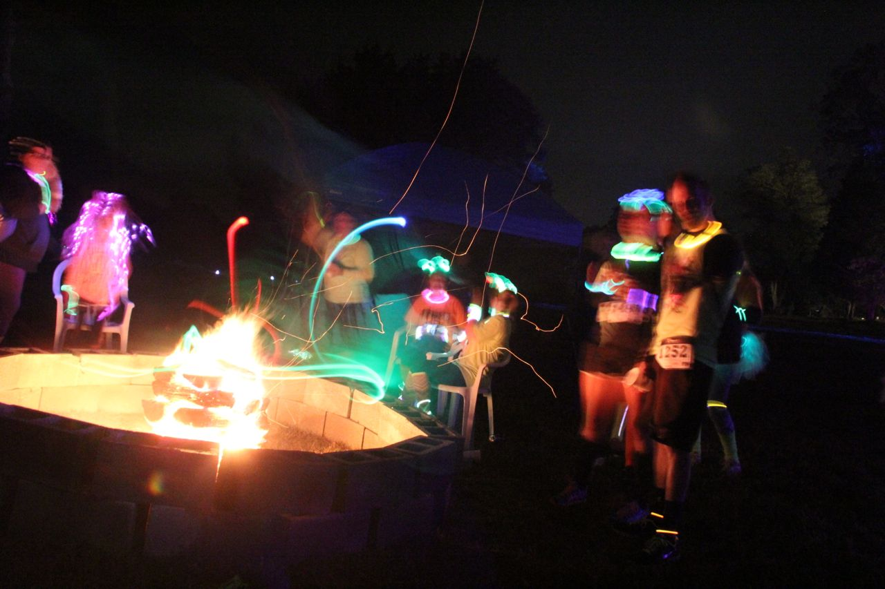 glow run after party in front of a fire