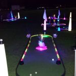 Glow golf putting track on tourlinks base