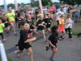 kids running in neon glow run