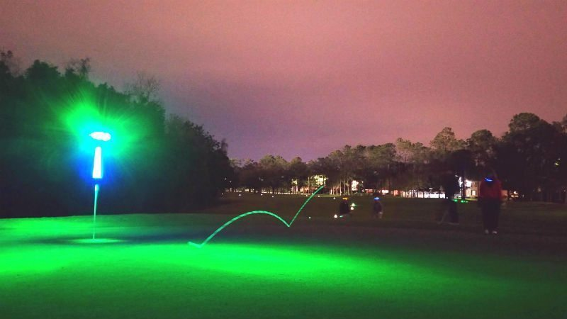 Chip shot during night golf nationals