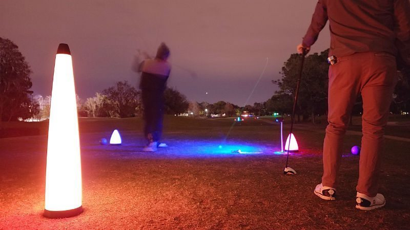 night golf tee shot during the nationals