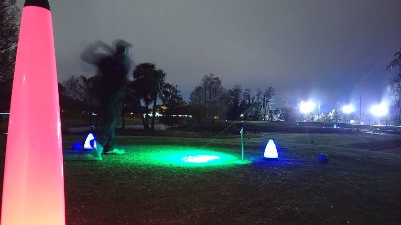 playing glow golf at night