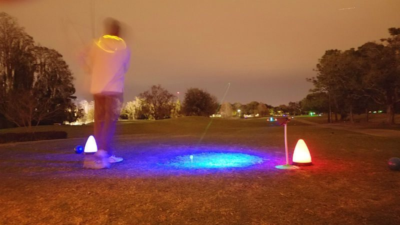 tee shot during night golf event